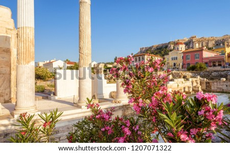 Sunny view of the Library of Hadrian, Athens, Greece. It is one of the main landmarks of Athens. Beautiful scenery of Athens with ancient Greek ruins. Historical architecture of Athens in summer.