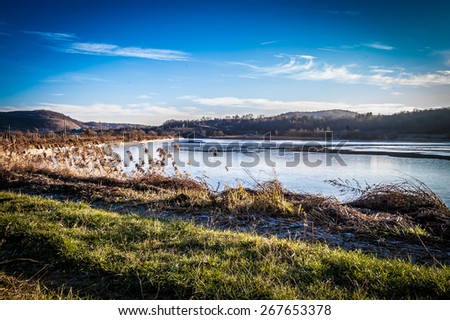 Sunny winter day on a lake, with nobody, landscape, with sun lights