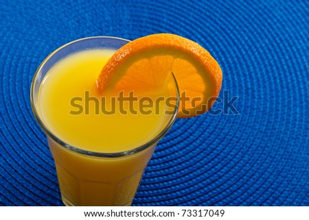 Sunny yellow fresh natural orange juice is full of Vitamin C and Potassium making it a healthy beverage and a great choice for breakfast in the morning.