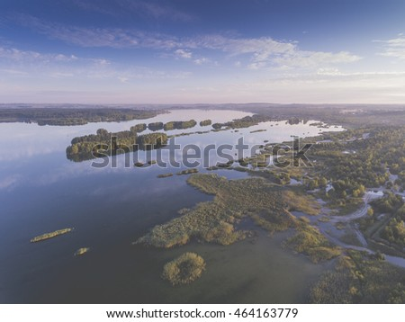Stock Photo Sunraise morning summer time lake and green forest, in Poland lanscape. View from above.