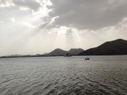 Sunrays coming through clouds falling upon Fateh Sagar