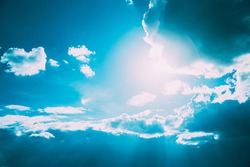 Sunrays Sunray Shine Through Dark Clouds In Cloudy Blue Sky. Natural Background. Natural Sky Backdrop Weather Conditions. Cloudy Sky With Fluffy Clouds. Sunset Sky Natural Background. Sunrays, sunray
