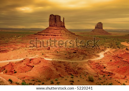 Sunrays through clouds at sunset, Monument Valley - stock photo