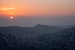 Sunrise above shady hills in the middleeast.