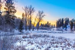 Sunrise along the Whitefish River, Montana on a frigid winter's morning