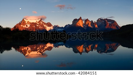 Sunrise & Alpenglow at Torres del Paine National Park, Patagonia, Chile: The Majestic Cuernos del Paine (Horns of Paine) Reflect in Lake (Lago) Pehoe.