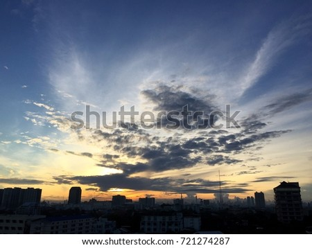 Sunrise and a beautiful cloudy sky in Bangkok, capital city of THAILAND, Silhouette city. #721274287