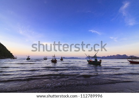 sunrise and boat in the sea