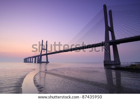 Sunrise and bridge over tagus river in Lisbon Portugal