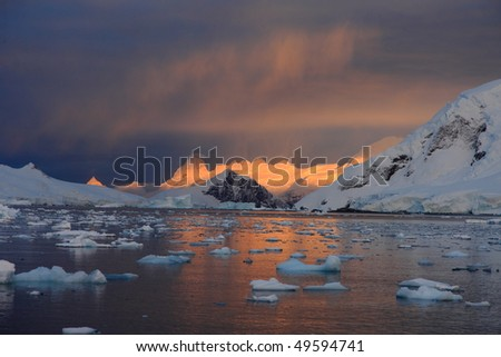 Sunrise and ice floe in Antarctica