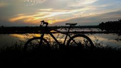 sunrise and mountain bike straight horizontally