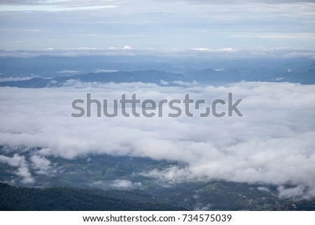 Sunrise and sea of mist, view from Doi inthanon national park  at Chiangmai province ,North of Thailand #734575039