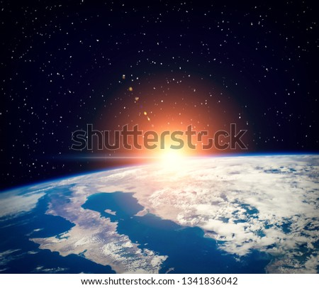 Sunrise and stars. The elements of this image furnished by NASA. #1341836042