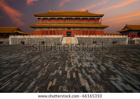 Sunrise at a building adjacent the Hall of Supreme Harmony in the Forbidden City, Imperial Palace complex in Beijing, China