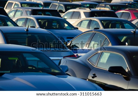 Sunrise at a jam packed parking sales lot with many rows of automobiles. #311015663