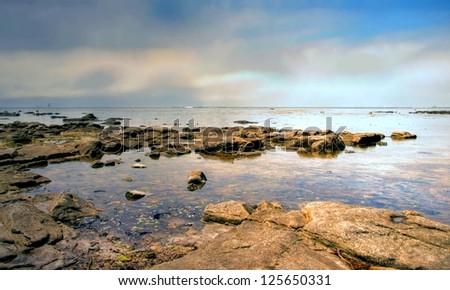 sunrise at a rocky beach in the south of France, Europe