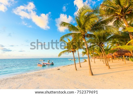 Shutterstock Sunrise at Akumal beach, paradise bay at Riviera Maya, caribbean coast of Mexico