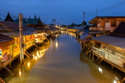 Sunrise at Amphawa floating Market and thai cultural for tourist destination.