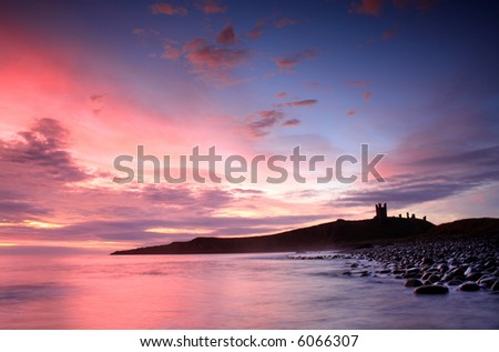 Sunrise at Dunstanburgh Castle on the North East coast of England