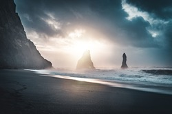Sunrise at famous Black Sand Beach Reynisfjara in Iceland. Windy Morning. Ocean Waves. Colorful Sky. Morning Sunset.