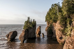 Sunrise at famous Hopewell Rocks geologigal formations at low tide biggest tidal wave Fundy Bay New Brunswick Canada