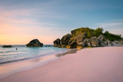 Sunrise at Horse Shoe Bay in South Hampton, Bermuda with an early riser swimmer
