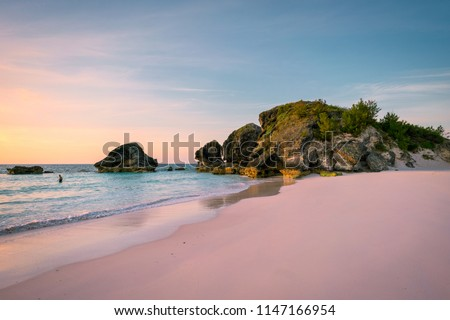 Sunrise at Horse Shoe Bay in South Hampton, Bermuda with an early riser swimmer Сток-фото ©