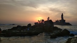 Sunrise at Kanyakumari, India. Kanyakumari is the southernmost part of Indian mainland. The Sunrise looks beautiful from this place. The statue visible in the photograph is Thiruvalluvar Statue.