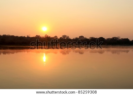 Sunrise at Kavango river whit mist on the water surface, Caprivi region. Namibia