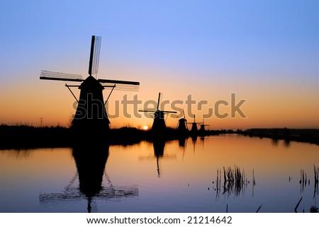 Sunrise at Kinderdijk windmill park, Holland.