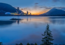 Sunrise at Lac des Arcs and the Exshaw cement plant in Alberta, Canada