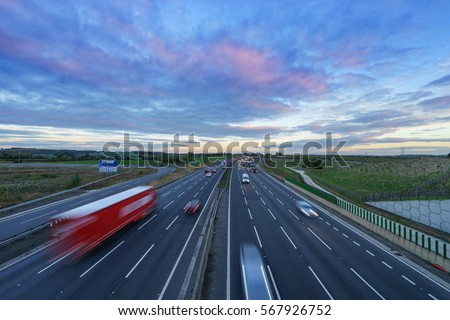 Sunrise at M1 Motorway with cars in motion