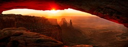 Sunrise at Mesa Arch stone arch, Canyonlands National Park, near Moab, Utah, United States