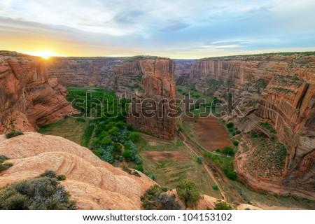 Sunrise at Navajo Fortress separates Canyon del Muerto from Black Rock Canyon. Canyon de Chelly NM, Arizona.