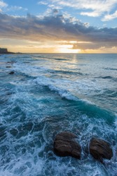 Sunrise at Newcastle Beach - New South Wales Australia. Located on the coast a few hours north of Sydney Newcastle is the largest regional  city in Australia.