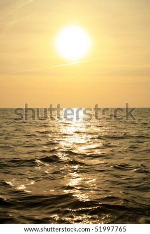 Sunrise at North Sea. Visible corona of the sun.