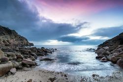 Sunrise at Penberth Cove a small beach near Land's End in Cornwall