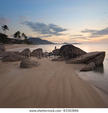 Sunrise at rocky coast of Lamai beach, Koh Samui Island, Thailand - stock photo