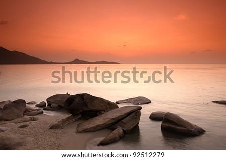 Sunrise at rocky seascape, Koh Samui Island, Thailand