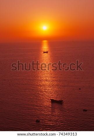 Sunrise at sea - stock photo