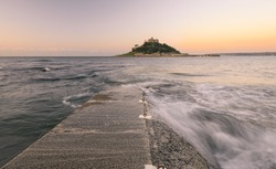 Sunrise at St Michael's Mount, a tidal island off Marazion near Penzance, Cornwall, England, United Kingdom. The island is linked by a causeway passable between mid-tide and low water
