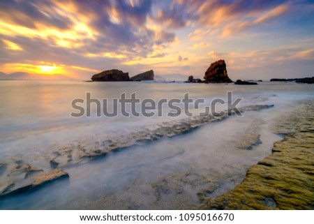 Sunrise at Tanjung Papuma beach, Jember, East Java, Indonesia #1095016670