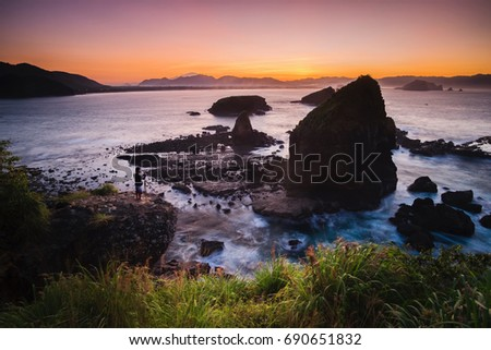 Sunrise at Tanjung Papuma beach, Jember, East Java, Indonesia #690651832