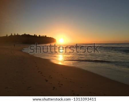 sunrise at the beach #1313393411