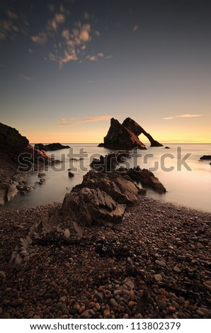 Sunrise at the Bow Fiddle rock, rock formation. Photographed at Portknockie, Moray,Scotland.