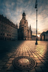 Sunrise at the Dresden Frauenkirche. Neumarkt in Germany. Well-known building, tourist magnet. Church and religion perfectly restored