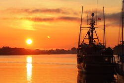 Sunrise at the marina in Steveston Harbor, British Columbia, Canada where the commercial fishing fleet waits for the fishing season to open. Located at the mouth of the Fraser River near Vancouver.