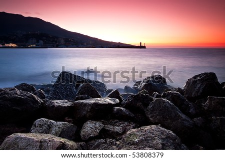Sunrise at the rocky shore of Black sea. Yalta, Crimea, Ukraine