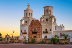 Sunrise at the San Xavier Mission Church in Tucson, Arizona. This historic spanish catholic mission was founded in 1692 and is located on the Tohono O'odham Nation indian reservation.