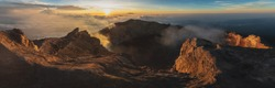 sunrise at the top of agung volcano. crater view. Higher than clouds. rinjani view. High quality panorama photo. Bali - island of gods. Indonesian mountains. trekking rote to summit. eruption